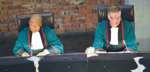 Chief Justice, Mogoeng Mogoeng (left) and Justice Johann van der Westhuizen delivering his last judgment in the Constitutional Court.