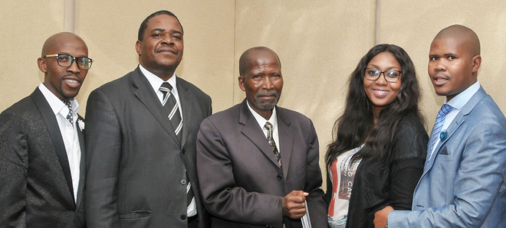 From left: Attorneys Simphiwe Pata; Qengebe Gcanga; Odwa Nyembexi (standing in for Lesly-Ann Brauns); and Zuko Tshutshane, pictured with the Attorney Development Fund's Mackenzie Mukansi (second), were recently awarded with equipment for their law firms.
