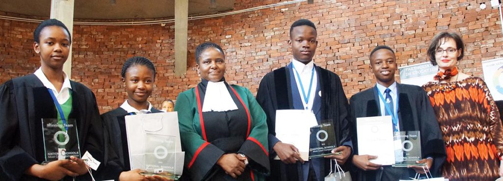 Winners of the sixth National School Moot Court Competition, from left: Emihle Majikija, Aviwe Vilane, Thembinkosi Msiza, Surprise Mahlangu with Justice Nonkosi Mhlantla (middle) and director of the Pro Bono and Human Rights department at Cliffe Dekker Hofmeyr, Jacquie Cassette (right), at the Constitutional Court.